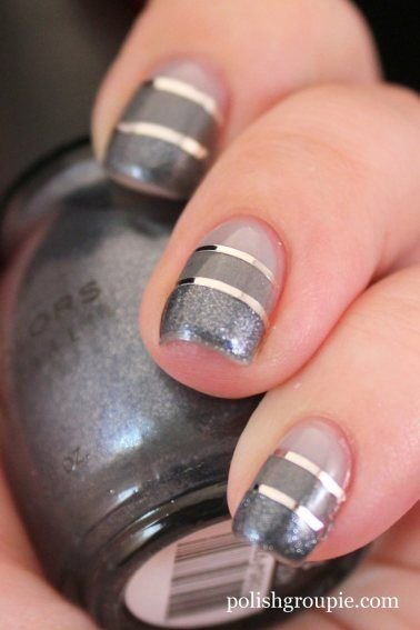 Grey toned striping tape mani. I love these metallic colours and the way they create a sort of ombre look. Pale grey base with a shimmery mid-grey colour and a dark grey with silver glitter - and striping tape between layers