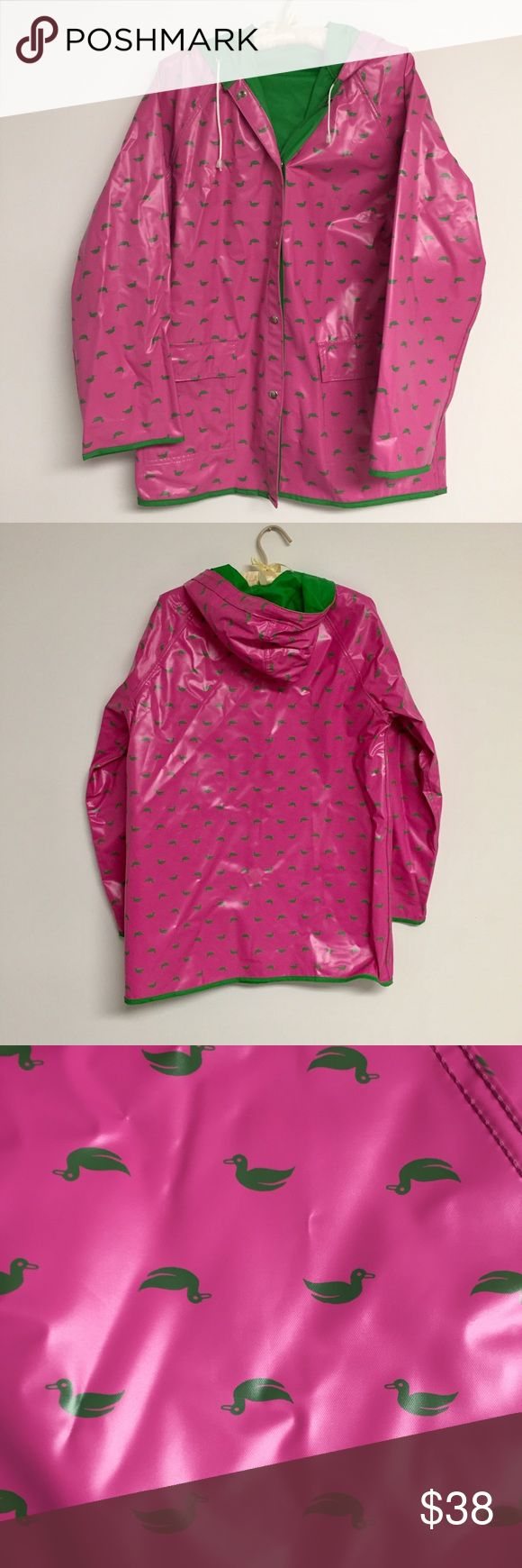 """Vintage 1980s Pink Ducks Hooded Rain Coat Jacket Vintage 1980s Pink Green Ducks Hooded Rain Coat Slicker Jacket size XL Green ducks on a pink background Green interior Snap up  front Full hood with drawstring for adjustment Long sleeves Air vents at the armpits Twin front pockets Hits below the hip About 22"""" across the chest from sleeve to sleeve, 22"""" waist, 31.5"""" top to bottom Pristine condition! Feel free to make me an offer! Jackets & Coats"""