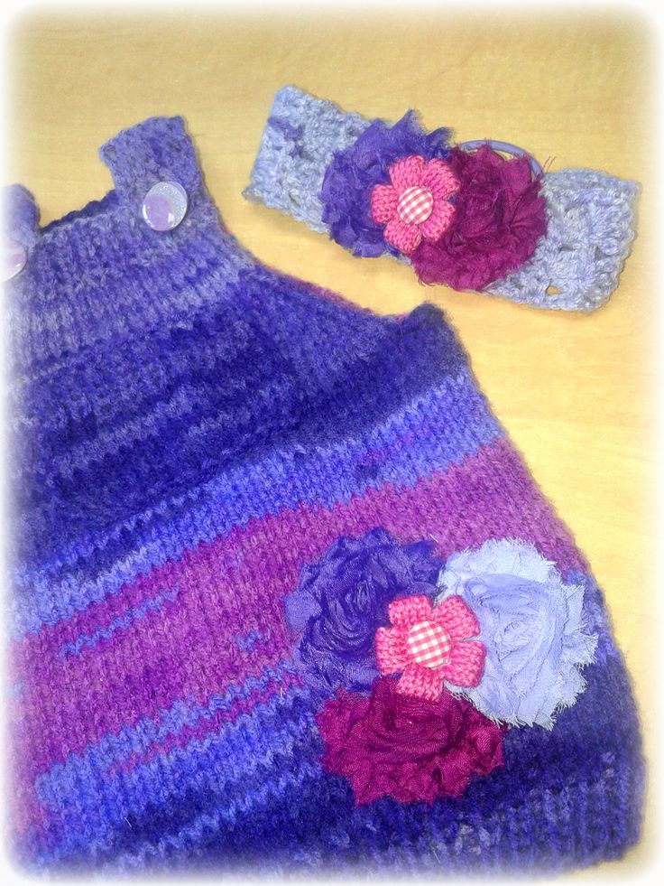 Hand knitted baby dress, with alize burkum batik yarn and a size 6 knitting needles. Decorated with silky flowers and a knitted flower on top. wwwbabybasket.etsy.com