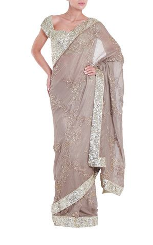 Seema Khan Timeless gold sequinned saree with matching, fully sequinned, gold blouse with cute heart shaped neckline. #Saree #Gold #Indianfashion #Sequinblouse #Designer