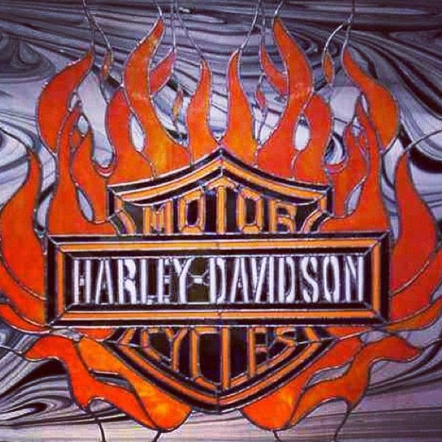 ...my stained glass Harley-Davidson logo with flames. Drew the glass pattern over twenty years ago. It's almost 300 pieces of glass. The background was a Spectrum baroque clear and black swirl glass; had to cut each piece without making a mistake, creating a continuous flow. Great way to challenge yourself and the effect really adds depth. I used fav Youghiogheny orange stipple for the flames. ✨ #stainedglass #art #glass #HD #HarleyDavidson #ooak #flames #motorcycle #logo