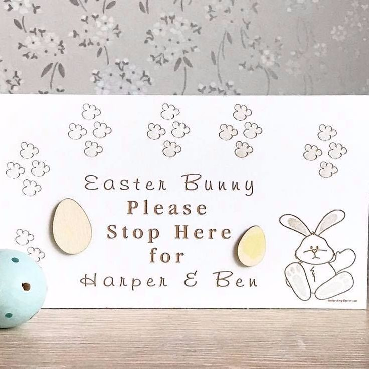 A beautiful handmade white freestanding decorative block sign engraved with little bunny paw prints and a cute Easter Bunny This pretty block sign is