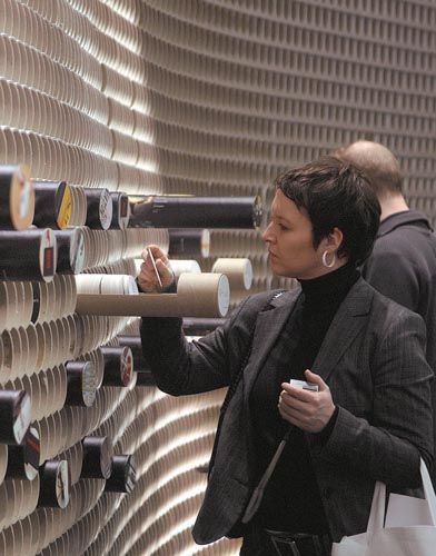 """""""Designers from D'Art Design Gruppe created paper coasters that featured hand-sketched fictional projects as well as renderings of actual Projektpilot works, then placed them inside three dozen of the cardboard tubes for visitors to inspect."""""""