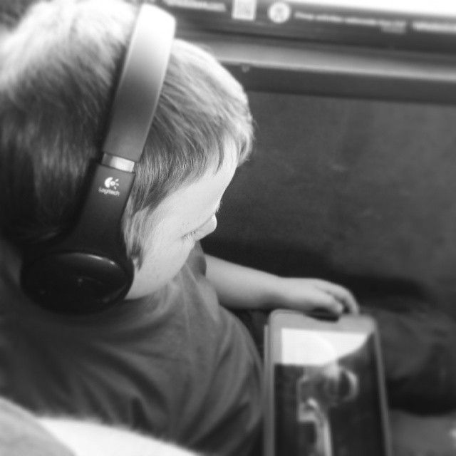 Long bus trips with kids - the BEST EVER reason to buy a tablet, and a set of the H800 wireless headphones from Logitech.