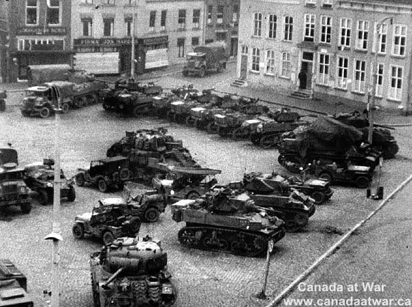 The Battle of the Scheldt - Sherman tanks of the 5th Canadian Armoured Division in town square. 31 Oct 1944, Bergen-op-Zoom, Netherlands.