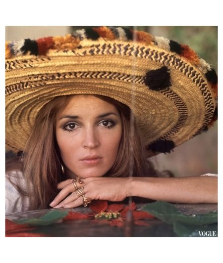 Talitha Getty poses beside a fountain wearing a wide brimmed hat worn by Marrakech farm women circa January 1970, photo by Patrick Lichfield