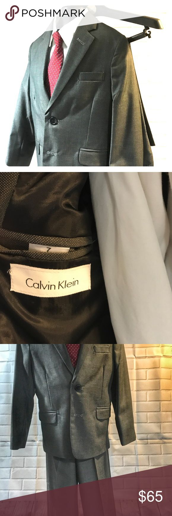 Calvin Klein Youth Charcoal Grey Two piece..Suit Perfect little boys Calvin Klein charcoal grey two piece suit. Wear for any occasion. Item worn once and dry cleaned immediately.. Calvin Klein Collection Matching Sets