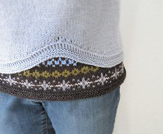 This is a seamless pullover worked from top down with raglan sleeves, and fairisle colorwork at the hem.