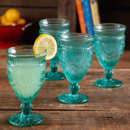 Matches our other random globlets, lol.   The Pioneer Woman Adeline Embossed 12-Ounce Footed Glass Goblets, Set of 4 - Walmart.com