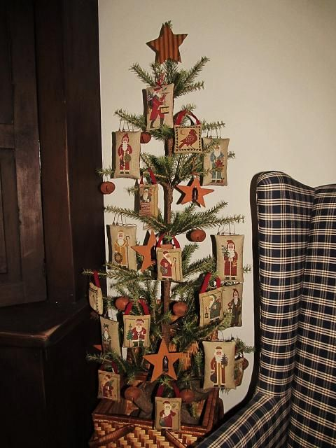 Prairie Schooler Santas Cross Stitch Handmade Ornaments ~ Beautifully displayed on a primitive country Christmas tree accented with rusty jingle bells and stars.  (Samplers and Santas blog)