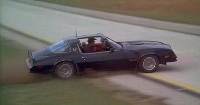 Bandit Trans Am crossing the median