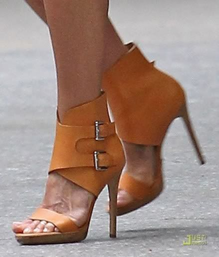 Jennifer Aniston in Michael Kors ankle cuff stilettos.