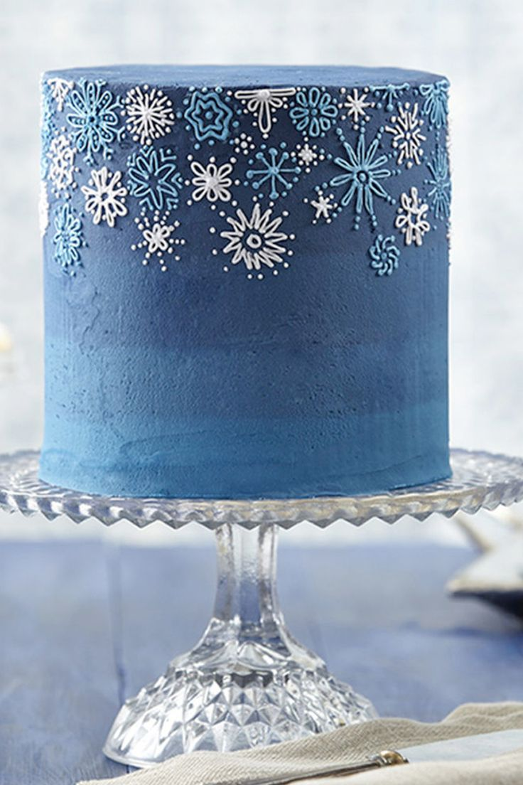 Celebrate snow, winter and your wedding with this snowflake-decorated buttercream cake. Wilton Delphinium Blue Icing Color and Sky Blue Icing Color create the deep blue dramatic background to show off the pale blue and pale violet piped snowflakes. Make this delightful cake yourself. Instructions here.