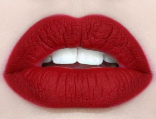 how to get the perfect red lips: apply a light colored lip balm. next line your lips heavily with a clear lip liner. then apply several coats of a red lipstick with a makeup brush, not a stick of lipstick, blotting with a tissue between each coat.