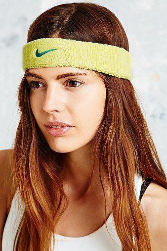 Nike Gelbes Stirnband mit Swoosh-Logo