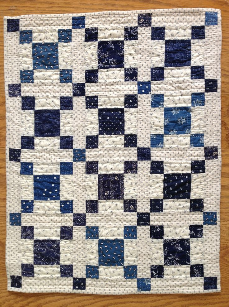 This is a doll quilt. We could make one about 10 times this big and have a ton of white space for you--- plus navy is your color....like the illusion of depth in this pattern