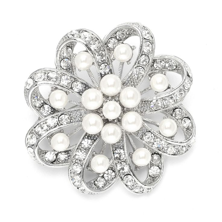 """This beautifulregal 2"""" round wedding brooch has soft cream pearls & crystals artfully set in a vintage floral swirl. This antique plated brooch can be worn on a gown, bridal sash, faux fur wrap."""