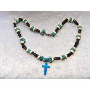 Turquenite nuggets, ostrich shell beads, genuine black hand painted bamboo, turquoise cross pendant. Lobster clasp.