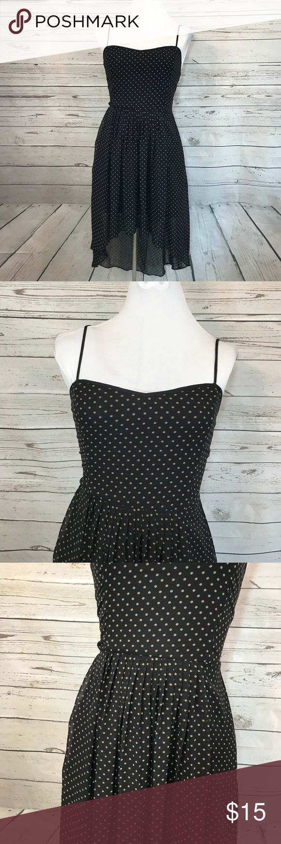 """Forever 21 black tank Polka Dot high low dress Fun Forever 21 black dress with tan polka dot mini dress. High low sheer bottom. Size Small. Adjustable Straps. Stretchy back.    armpit: approx.  14"""" waist: approx.  12"""" length: approx. 34"""" (longer in the back) Forever 21 Dresses Asymmetrical"""