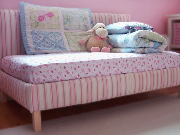 Precious Pink Bed Daybed With a Crib Mattress If you're updating an old nursery, repurpose the crib mattress into a daybed for a cozy spot to read a book or for overnight guests.