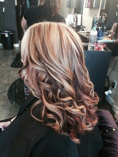 Heavy blond highlights with red lowlights