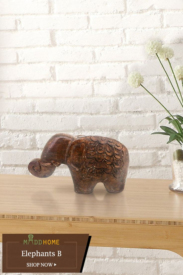 Elephants B: The large mammal of the woods carved in woods gives a ostentatious look.