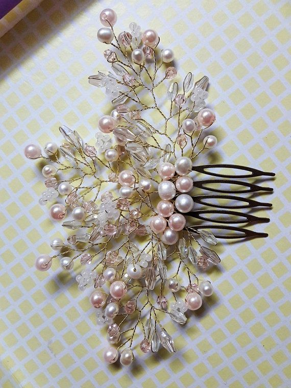 Breathtaking rose gold wedding hair piece. This rose gold bridal hair comb is rich in beautiful rose and ivory pearl beads, rose crystal beads that will allow this bridal hair accessory shining mysteriously in your hair. The branches of this bridal hair brooch are flexible that