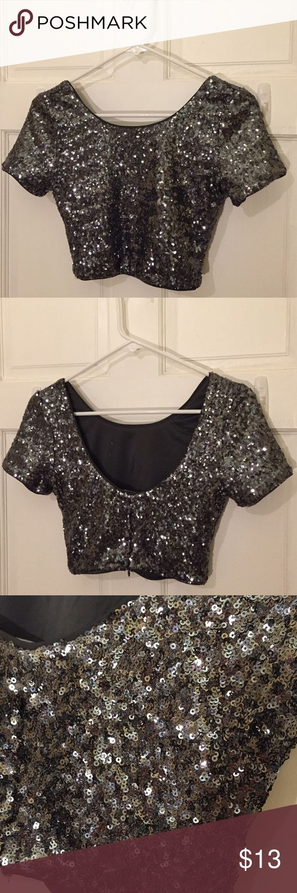 Sparkly Crop Top Light up your night life with this fun crop top. Features seen on sparkle flakes- NOT glitter that will come off. The perfect time for going out. Forever 21 Tops Crop Tops