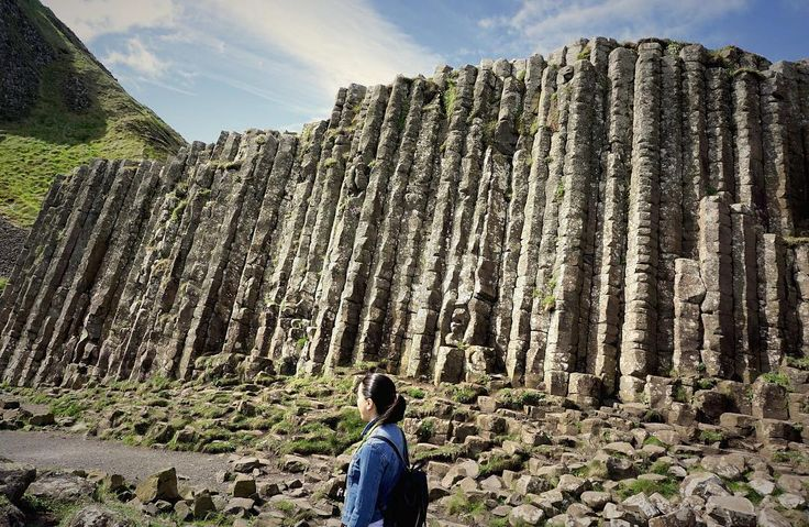The Giant's Causeway is a UNESCO World Heritage Site known for its unique rock formations of polygonal columns of layered basalt. A result of an ancient volcanic eruption.