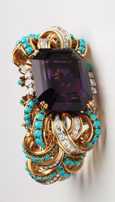 Bracelet by David Webb from 1961. Amethysts, turquoise, diamonds, gold, and platinum.
