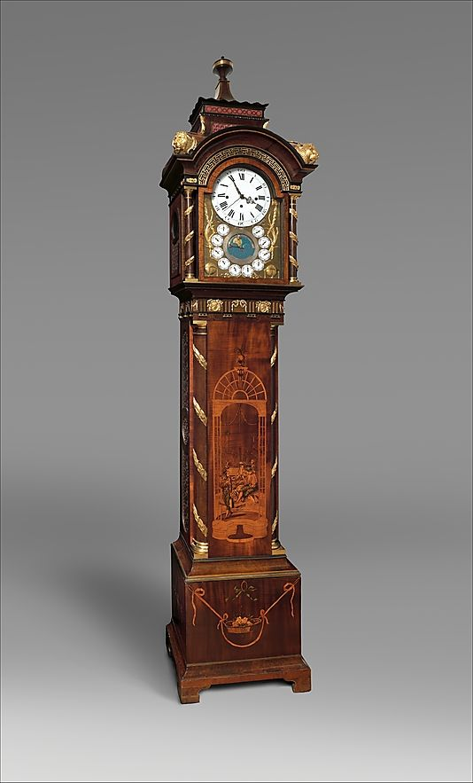 The case recalls prototypes published in Thomas Chippendale's Gentleman and Cabinet-Maker's Director. Below the main clock dial are the signs of the zodiac and the phases of the moon. The ring of auxiliary dials indicates the most important cities of the day (clockwise): Philadelphia