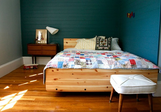 Love the color on the wall with the natural wood bed frame.