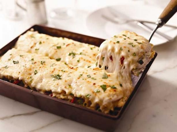 Creamy White Chicken & Artichoke Lasagna    Ingredients  2 cups boneless skinless chicken breast, cooked and shredded  1 can (14 oz.) artichoke hearts, chopped  1/2 cup chopped sun-dried tomatoes  1 pkg. (8 oz.) KRAFT Shredded Mozzarella Cheese with a Touch of PHILADELPHIA, divided  1/2 cup KRAFT Grated Parmesan Cheese  2 packages (8 ounces each) cream cheese, softened  1 cup milk  1/2 tsp. garlic powder  1/4 cup basil, chopped  12 lasagna noodles, cooked    Directions  Heat oven to 350°F…