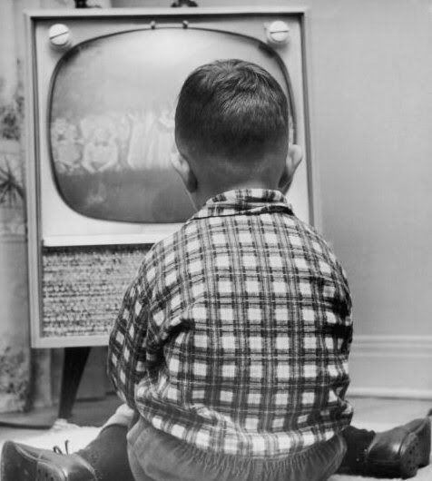 TV time, 1950s.  Get a gander at that TV...