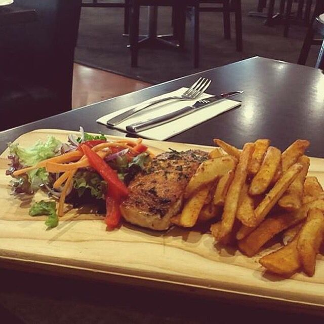 BAKED ATLANTIC SALMON // Served with Noci chips, garnish salad & homemade gremolata.