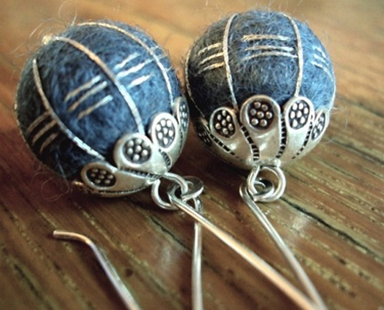 felted beads with wire cages and metal tops. I love those three little stitches per segment, too. Origially from Boston Bead Company blog
