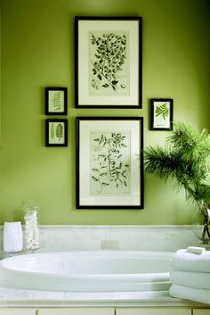 Beautiful green wall and great way to hang artwork in the bathroom
