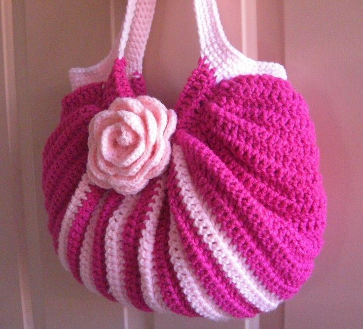 Crochet pink fat bottom bag with rose. I links to a photo stream but a few photos down the line is a crochet chart for the body for the bag.