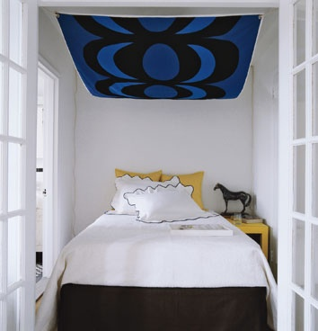 Very creative use of fabric adds pop of color to the space