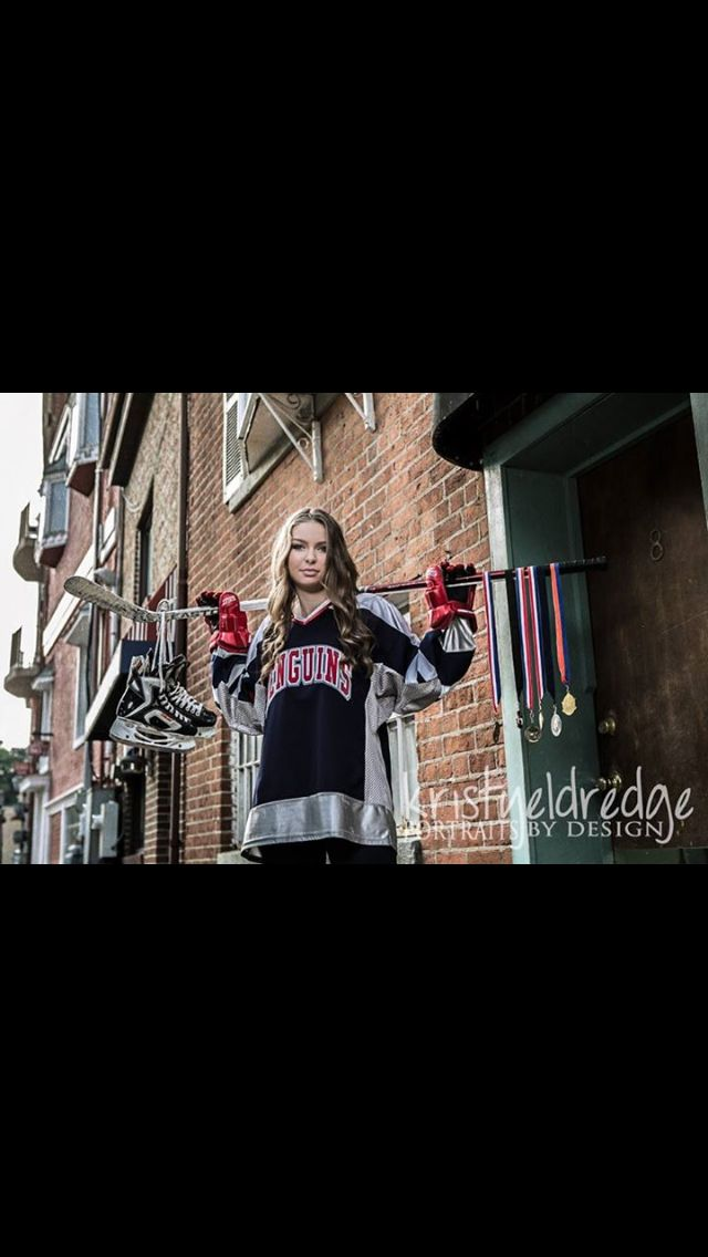 COPYRIGHT 2014 Kristy Eldredge - Portraits by Design.   Girl senior picture hockey pose