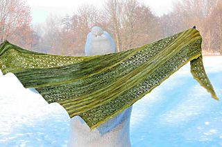 """""""DEEP FOREST"""" is an asymetric triangle-shaped shawl knited with two colors in a combination of old Shetland Lace pattern so called Cat's Paw and garter stitch pannels."""