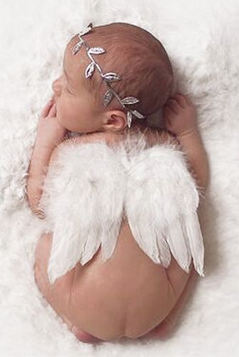 Product Details: This is a cute white angel wing with Silver leaf headband
