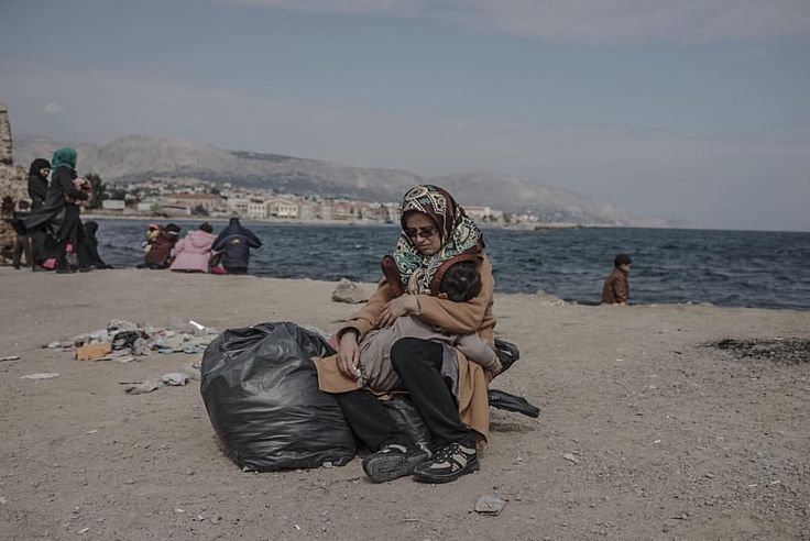An Afghan woman waits with her child  at a registration point on Chios, Greece. #chios #greece #migrantcrisis #refugeecrisis #refugees #afghan
