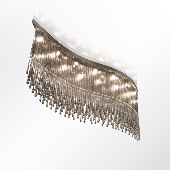 Dancer Ceiling Lamp I | The Dancer Ceiling Lamp I by MULTIFORME is a stunning creation, it is composed of 19 lights, it has a wavy structure with pendant glass elements an... view details on www.treniq.com