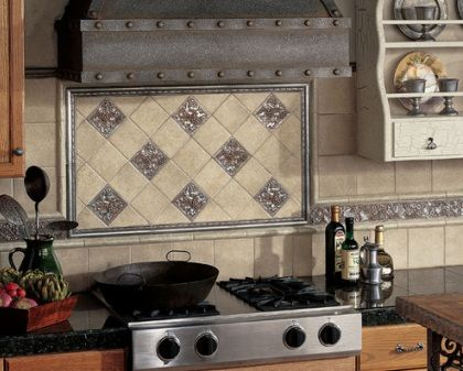 an extra design in the backsplash over the stove makes a great focal point for a kitchen backsplash