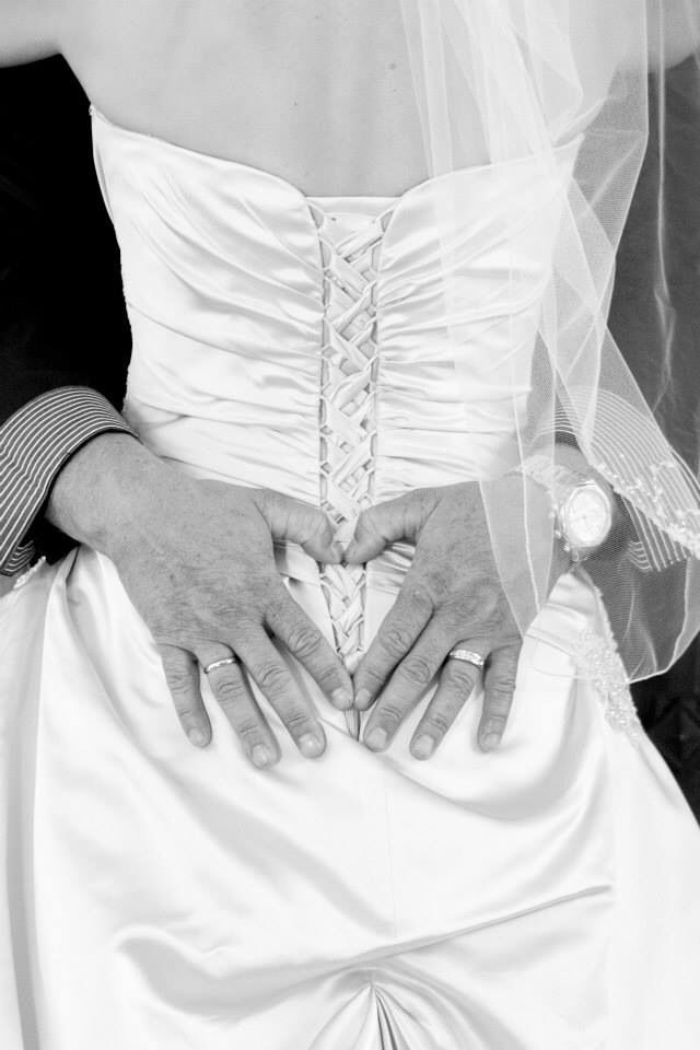 Jonno's hands forming a heart on the back of my dress. I'm going to have this photo made into a canvas