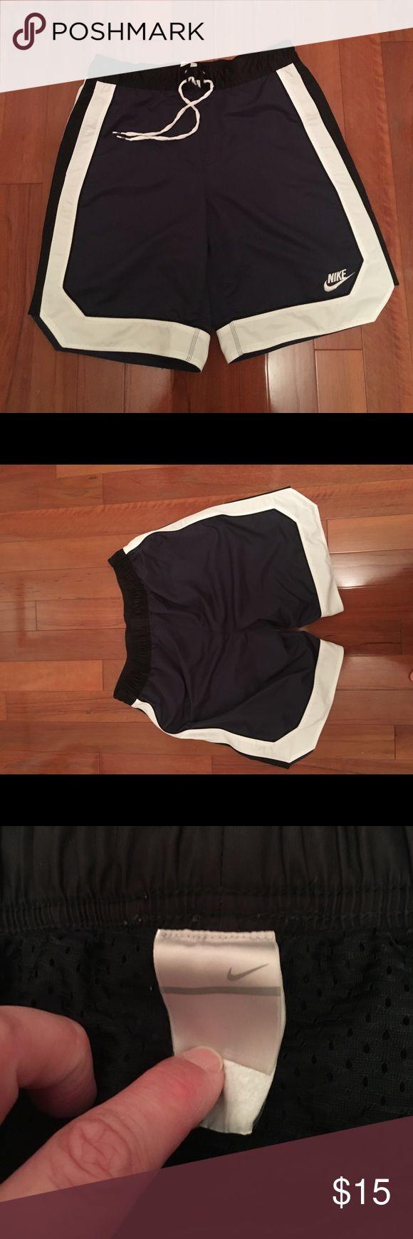 Nike swim shorts Nike blue and white swim shorts size large with elastic in back waistband Nike Swim Board Shorts