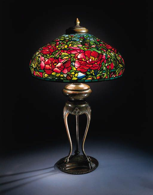 AN IMPORTAMT 'ELABORATE PEONY' LEADED GLASS AND BRONZE TABLE LAMP   Tiffany Studios   35in. (90.8cm.) high, 21in. (55.2cm.) diameter of the shade, with finial  the shade tag stamped TIFFANY STUDIOS NEW YORK 1903, the base stamped TIFFANY STUDIOS NEW YORK 439