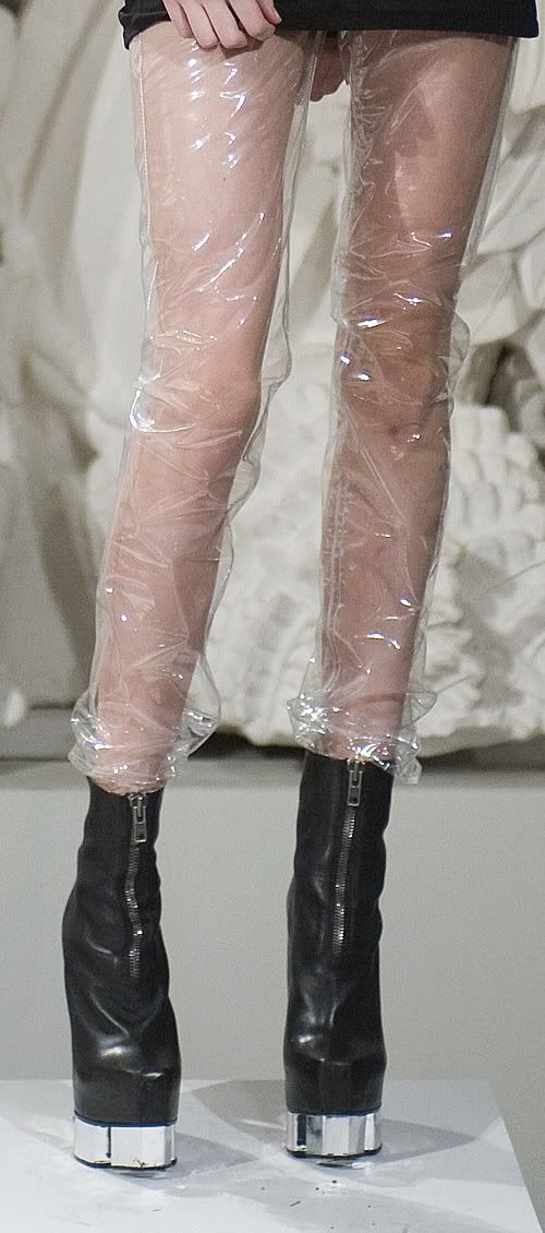 - EXTRA INSPIRATION - plastic wrapped around legs as accessory