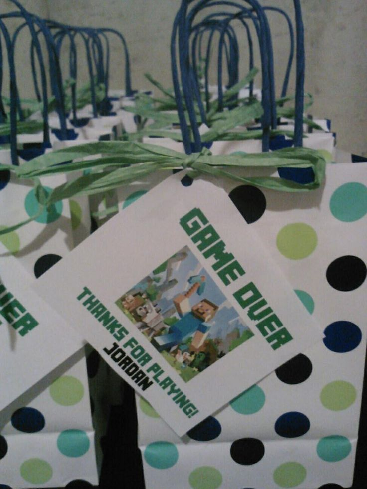 Minecraft goodie bags for my son's birthday party. Downloaded the font for my computer. Created the tags in MS PowerPoint. Tied the tags to the bags with rafia. So cute!